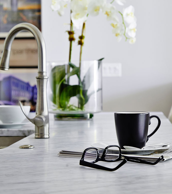 Image of counter top with glasses and coffee mug